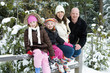 Family on fence is white winter snow