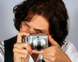 A Teen Takes a Picture with a Digital Camera