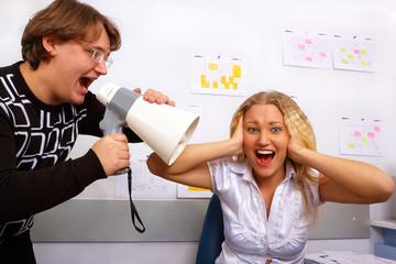 Office. Boss is screaming on secretary