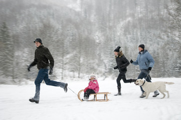 Happy family playing on winter