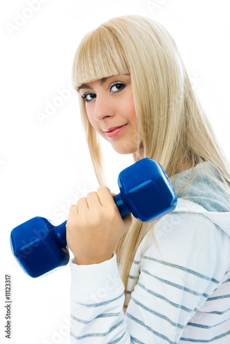 beautiful woman with dumbbells