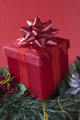 Red gift box on a Christmas tree