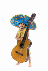Child with Mexican hat playing guitar .