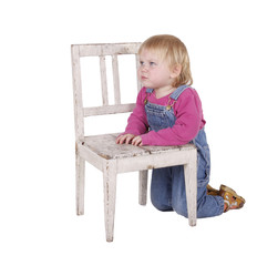 kneeling near chair young girl