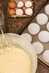 Kitchen utensils, ingredients and batter