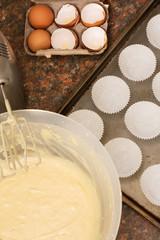 Kitchen utensils, ingredients and batter