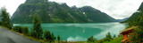 Panoramic view of an emerald lake among mountains