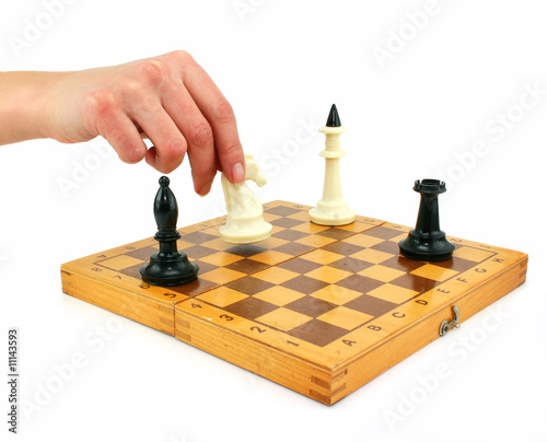 Chessboard and female hand gives check