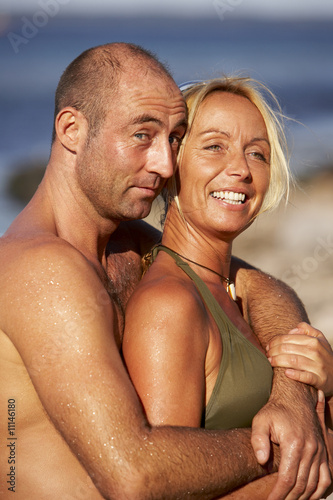 happy couple at the ocean