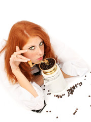 young red-haired girl and coffee grinder