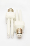 Two white electric economic lamps. poster