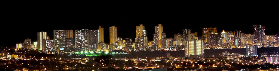 A panorama photo of Honolulu skyline at night