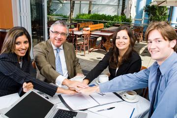 business team put hands together