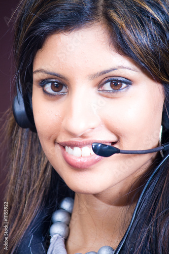 smiling indian business woman with headphones