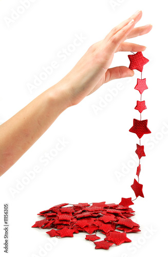 Female hand holds star-shaped garland