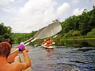 On kayaks.