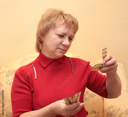 Elderly woman with tablets