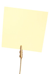 Closeup of yellow sticky note held by clip