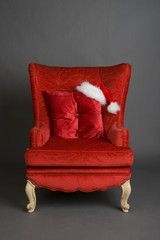 Bright red chair with santa hat