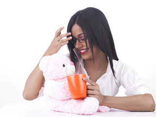 pretty girl with her pink teddy bear