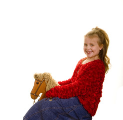 Girl in Red on Rocking Horse