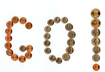 Interjections written with various coins, isolated on white.