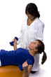 physical therapist helps a patient