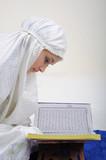 Muslim Women Reading Koran poster