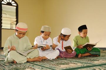 Muslim kids reciting Holy Koran