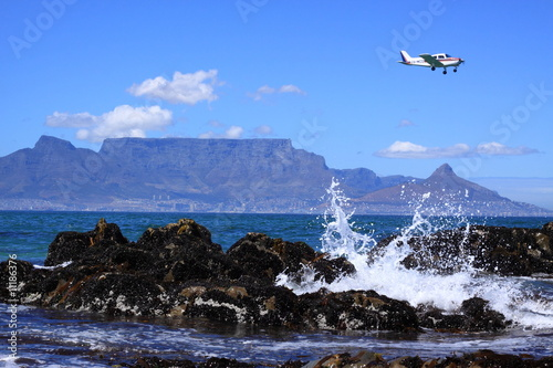 Plane over table mountain