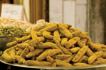 Heap of turmeric roots at an Asian spice market