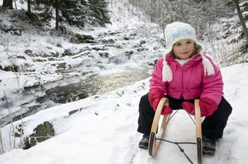 Little girl on  sledge