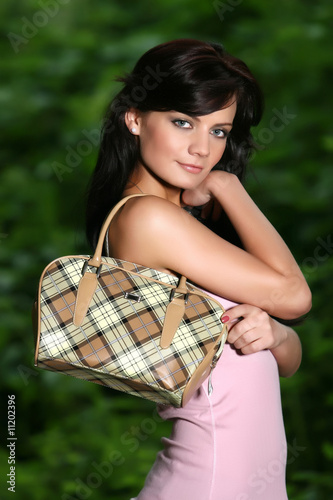 Pretty dark haired girl with handbag - modish -