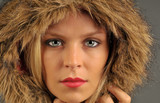 Beautiful woman with furry hood. poster