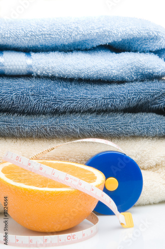 Pile of towels, tape measure and half of orange
