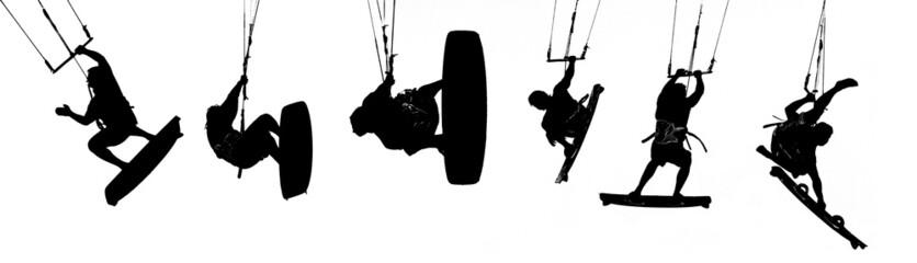 silhouettes of kitesurfer over white