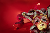 Ornate carnival mask over  textured metallic background