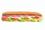 long sandwich with tomatoes, cucumbers, ham, turkey and cheese