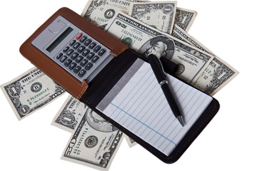 american money with notepad and calculator