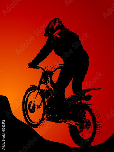 Silhouette of motobiker in the sunset