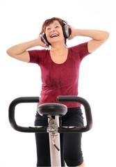 Senior spinning woman listening music