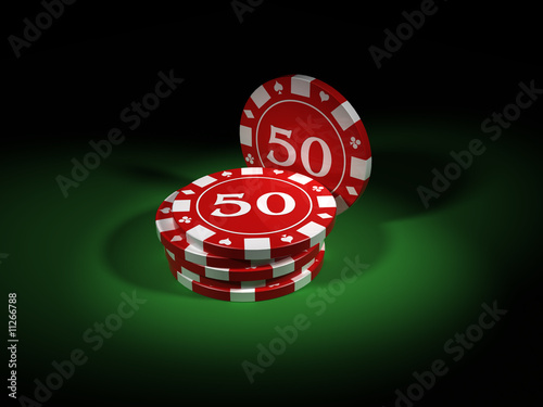 Poker chips close up over a green table