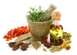 Mortar with fresh rosemary, oil and dried spices