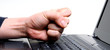 hand hitting laptop