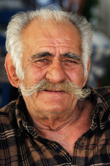 Senior Greek man with a big mustache