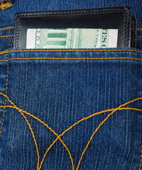Wallet with money in jeans' pocket