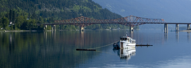 Panorama of a morred fishing boat in Nelson, BC, Canada