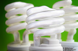 energy efficient light bulbs on green background poster