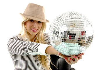 portrait of smiling woman showing disco ball