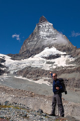 hiker showing famous Matterhorn mountain